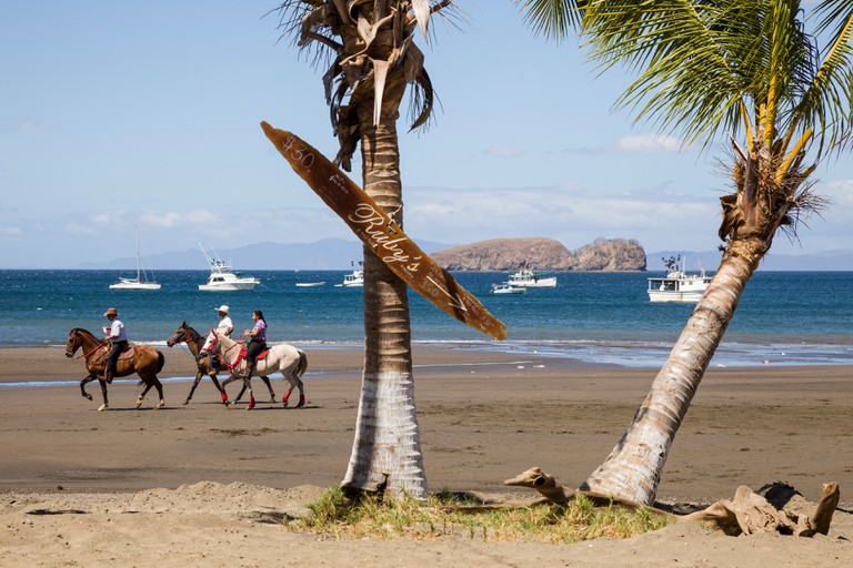 Riding horses along the shores of Playas del Coco, Guanacaste Province, Costa Rica.