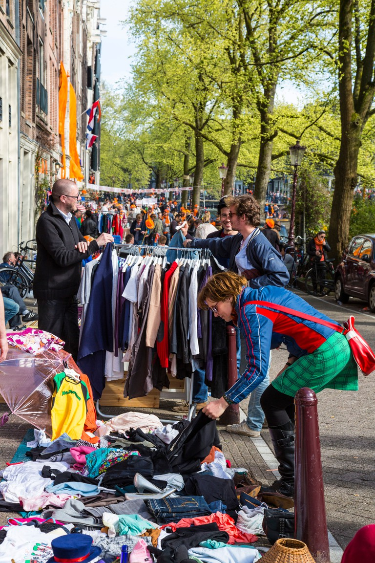 Flee market stands in the old town of Amsterdam on Kings day