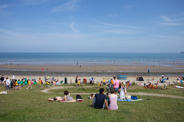 People relaxing at the seaside at Portmarnock, Dublin city, Ireland