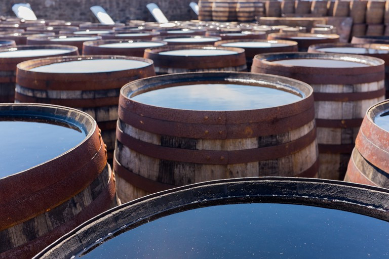 Whisky barrels outside a distillery yard