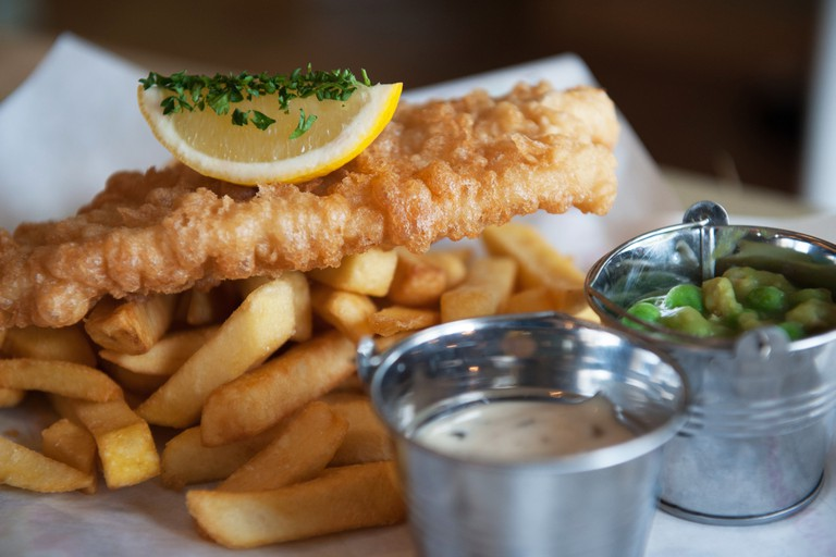 Britain's national dish: fish and chips with mushy peas and tartar sauce