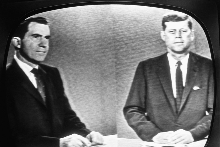 JFK and Nixon participate in the first televised presidential debate, 1960