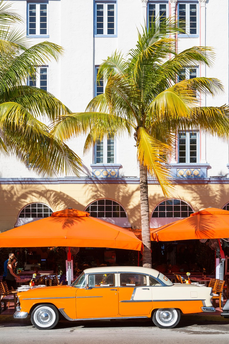 Art deco building and vintage car on Ocean drive