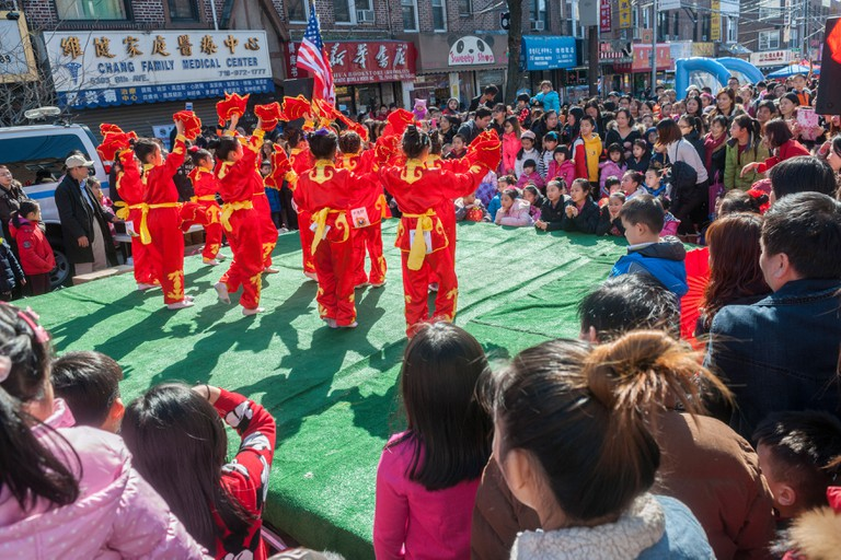 Dance performance on Eighth Avenue in the Sunset Park neighborhood in Brooklyn in New York during the 2016 Lantern Festival street fair.