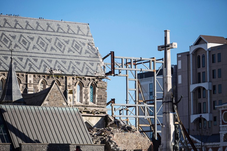 A cross stands next to the Christchurch Cathedral as it undergoes repairs in Christchurch, New Zealand.