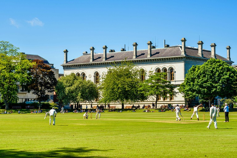 Cricket match on College Park, Trinity College, Dublin, Ireland.