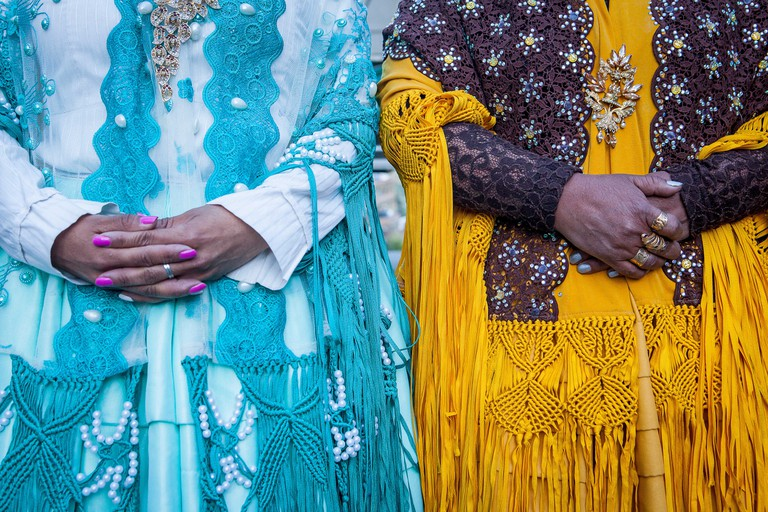 Detail of dresses and hands. At left Benita la Intocable , at right Angela la Folclorista, cholitas females wrestlers, El Alto,