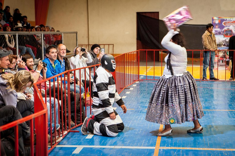 Lucha Libre. Combat between El Prisionero and the cholita Angela la folclorista, wrestlers ,Sports center La Ceja, El Alto, La P