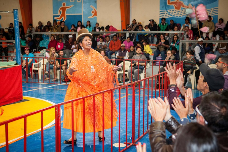 Lucha Libre. Dina acclaimed by the public before starting the combat, cholitas females wrestlers ,Sports center La Ceja, El Alto