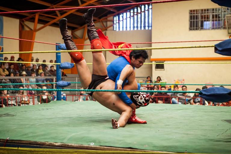 Lucha Libre. Wrestlers in combat, Sports center La Ceja, El Alto, La Paz, Bolivia