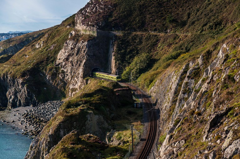 Dart train at Bray Head passing through tunnels (Bray-Greystones) in Dublin