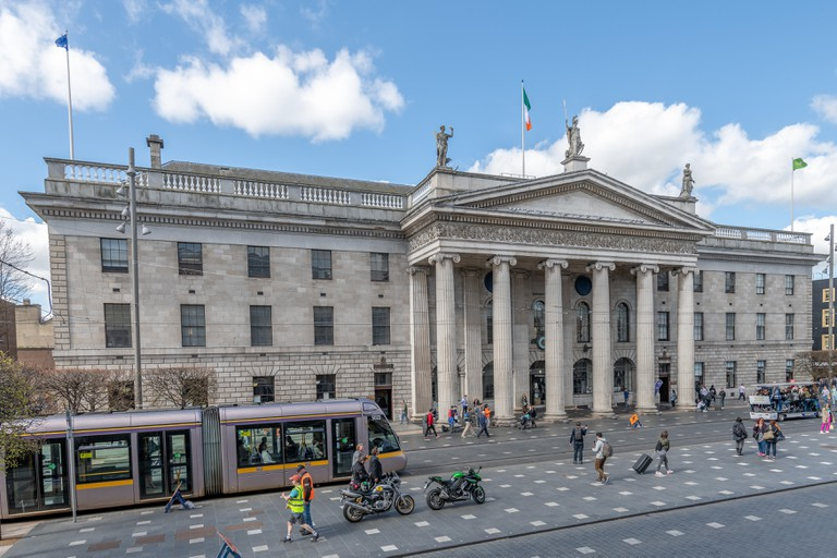 Luas tram passes in front of the GPO on a busy O'Connell Street, Dublin, Ireland