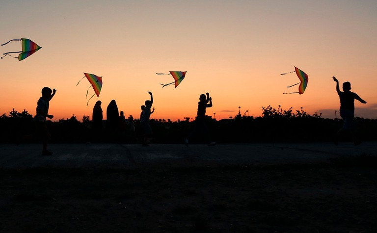 "Mandatory Credit: Photo by Hadi Mizban/AP/REX/Shutterstock (10163346a) Children launch kites during Nowruz celebration as the sun sets in Baghdad, Iraq, . Nowruz, the Farsi-language word for ""new year"", is an ancient Persian festival, celebrated on the first day of spring in countries including Iraq, Turkey, Afghanistan and Iran. The festival is a symbolic opportunity to purify the soul for the new year and symbolizes revival and is marked by spring cleaning, buying new clothes and planting trees. March 21, the first day of spring, marks Nowruz Nowruz Celebration, Baghdad, Iraq - 21 Mar 2019"
