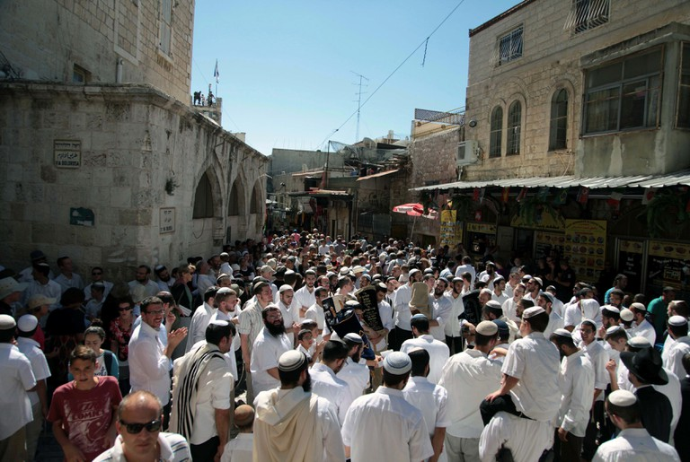 Ultra-Orthodox Jews march during the last day of Sukkot, Jerusalem, Israel