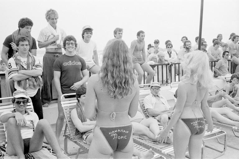 sb_Hawaiian Tropic girls_pool Spring Break: Rite of Passage. A 11 year photographic document of spring break in Daytona Beach, Florida - 1982-1993.