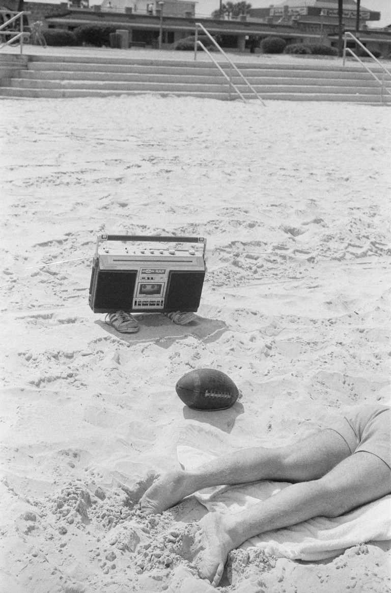 """""""That's kind of the photograph of being a man. That boom box is also kind of walking toward him on shoes. It's kind of a funny photograph."""" –Keith McManus"""