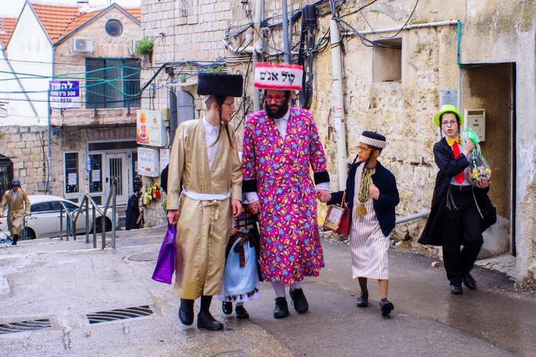 Ultra-orthodox Jewish men, some in costumes, as part of a celebration of the Jewish Holiday Purim