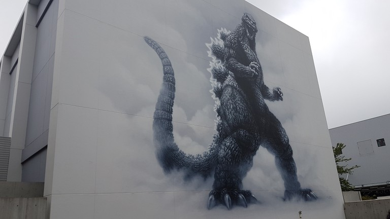 The Godzilla mural on the side of Toho studios
