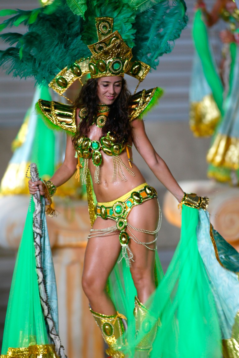 Woman with green feather headdress in Rio carnival parade