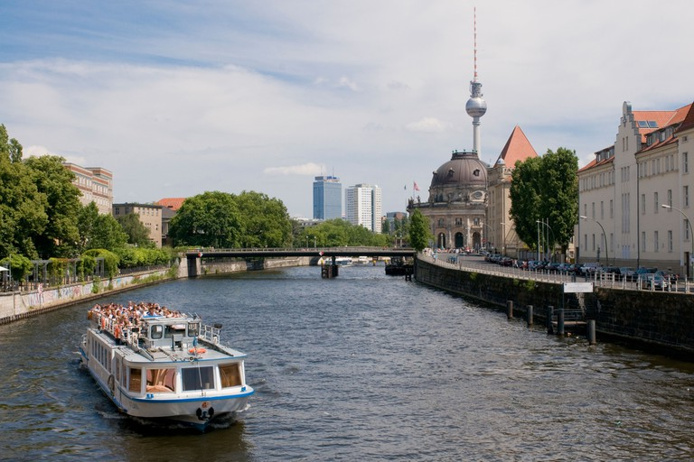 Tourist boat on the Spree in the background the museum island and the TV tower Berlin Germany