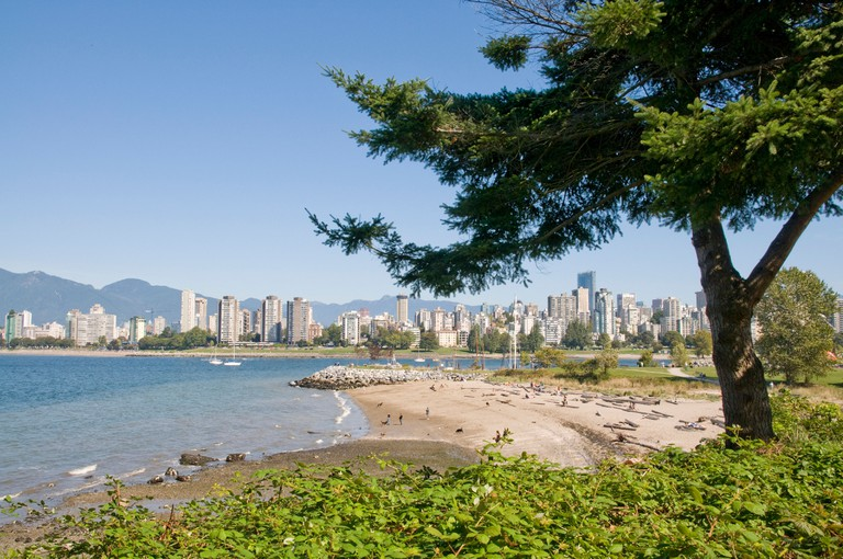 Kitsilano Beach park overlooking English Bay and the skyline of downtown Vancouver, Canada.