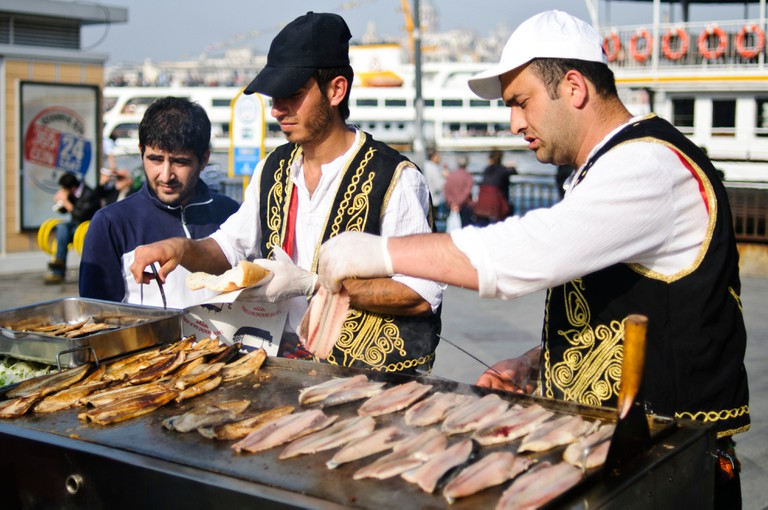 Cooking fish on an open grill on the waterfront of Eminonu near the Galata Bridge