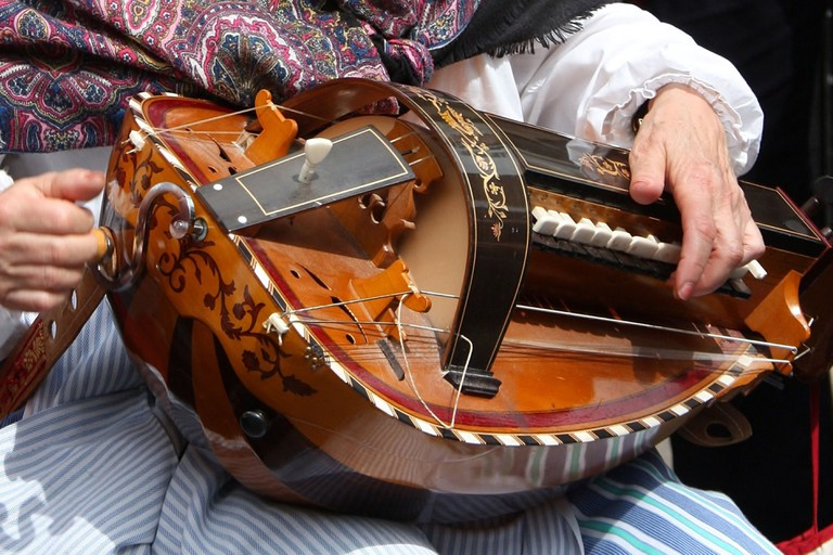 a Hurdy Gurdy Player or Gurdyist