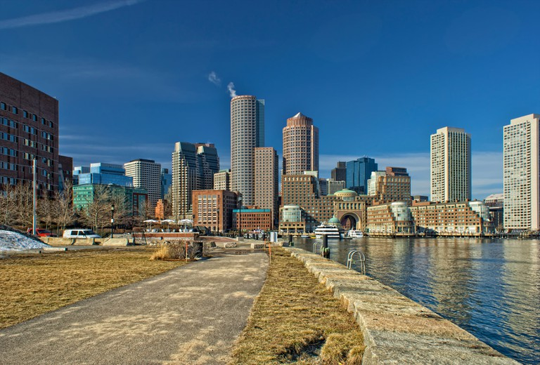 View of boston harbor and rowes wharf and skyscraper buildings in south boston.