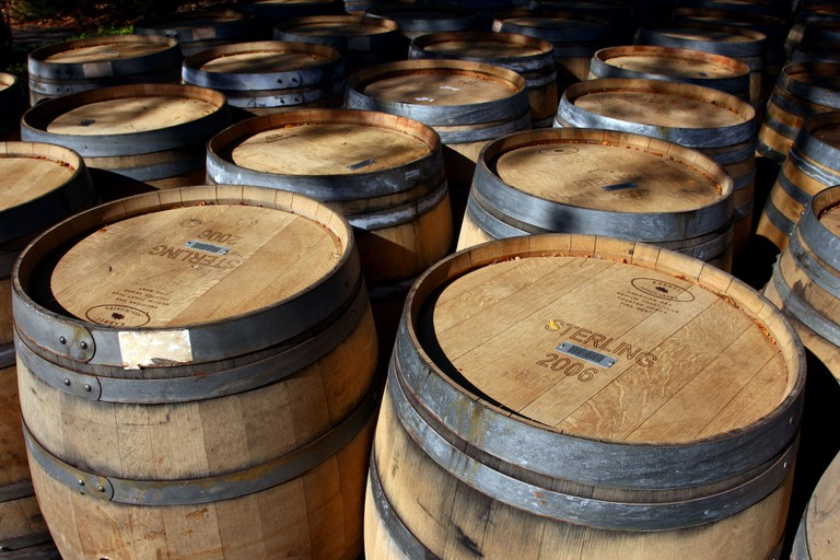 Lined up barrels in a brewery
