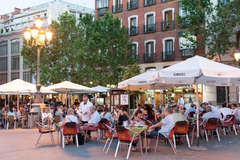 Busy bar tables on Plaza de Santa Ana, Barrio de las Letras, Madrid, Spain