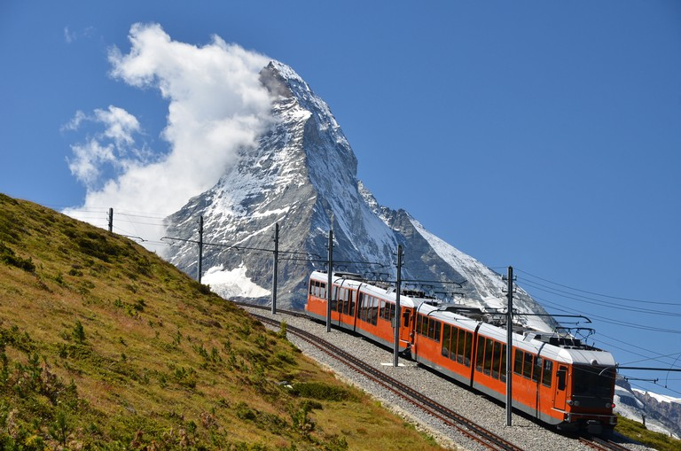 Train in Switzerland, with the Matterhorn landscape in distance, Zermatt.