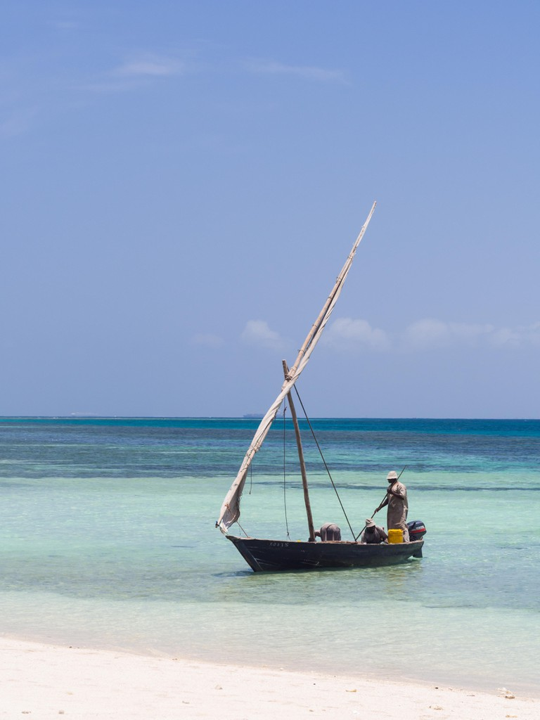 Tanzanian fishermen on a dhow boat on the beach on Mbudya Island in Tanzania.