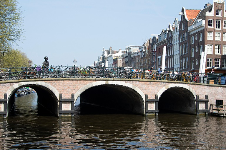Torensluis bridge, oldest bridge in the city, over the Singel canal in Amsterdam.