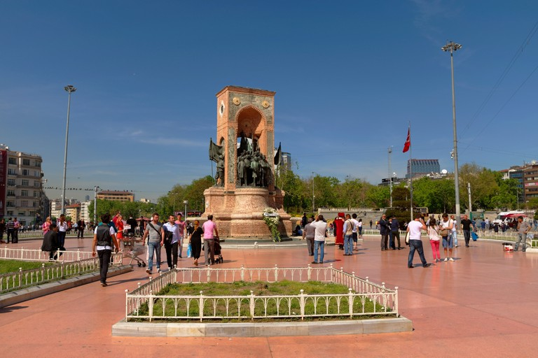 Taksim Square, Istanbul with the Republic Monument and Ataturk statue with Gezi Park in the background. Turkey