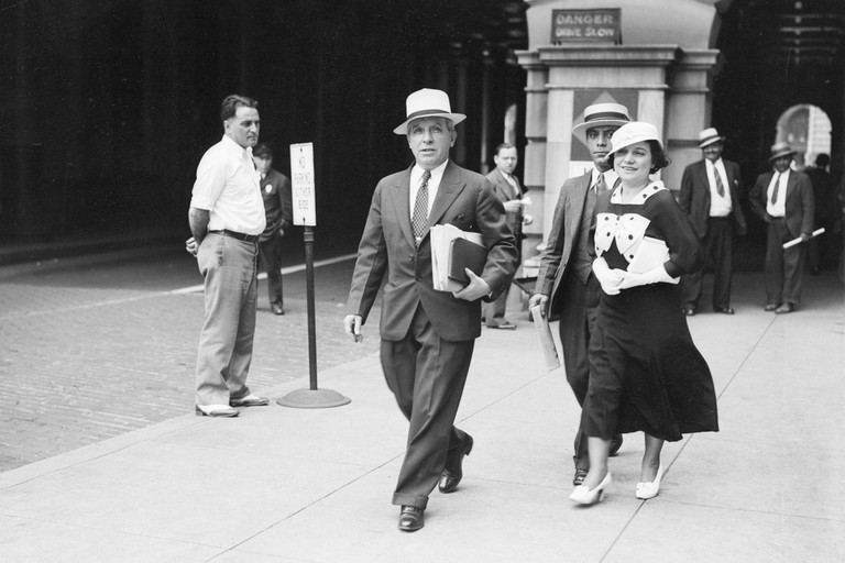 Antique photograph, Charles and Rose Ponzi on the day of a deportation trial in 1934, followed closely by an unknown individual, likely a lawyer. Charles Ponzi, (1882-1949) was an Italian businessman and con artist in the U.S. and Canada. He became known