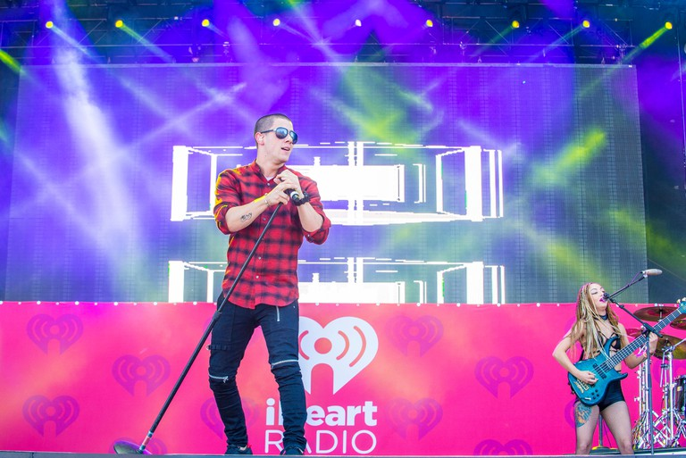 Nick Jonas performs onstage at the iHeartRadio Music Festival at the Las Vegas Village
