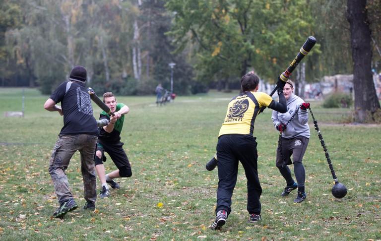 Members of Verein Jugger e.V. play Jugger in Volkspark Friedrichshain park in Berlin.