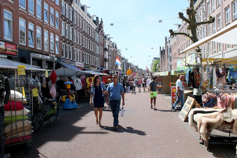Street vendors and people shopping at busy Albert Cuyp Market, de Pijp borough, Amsterdam.