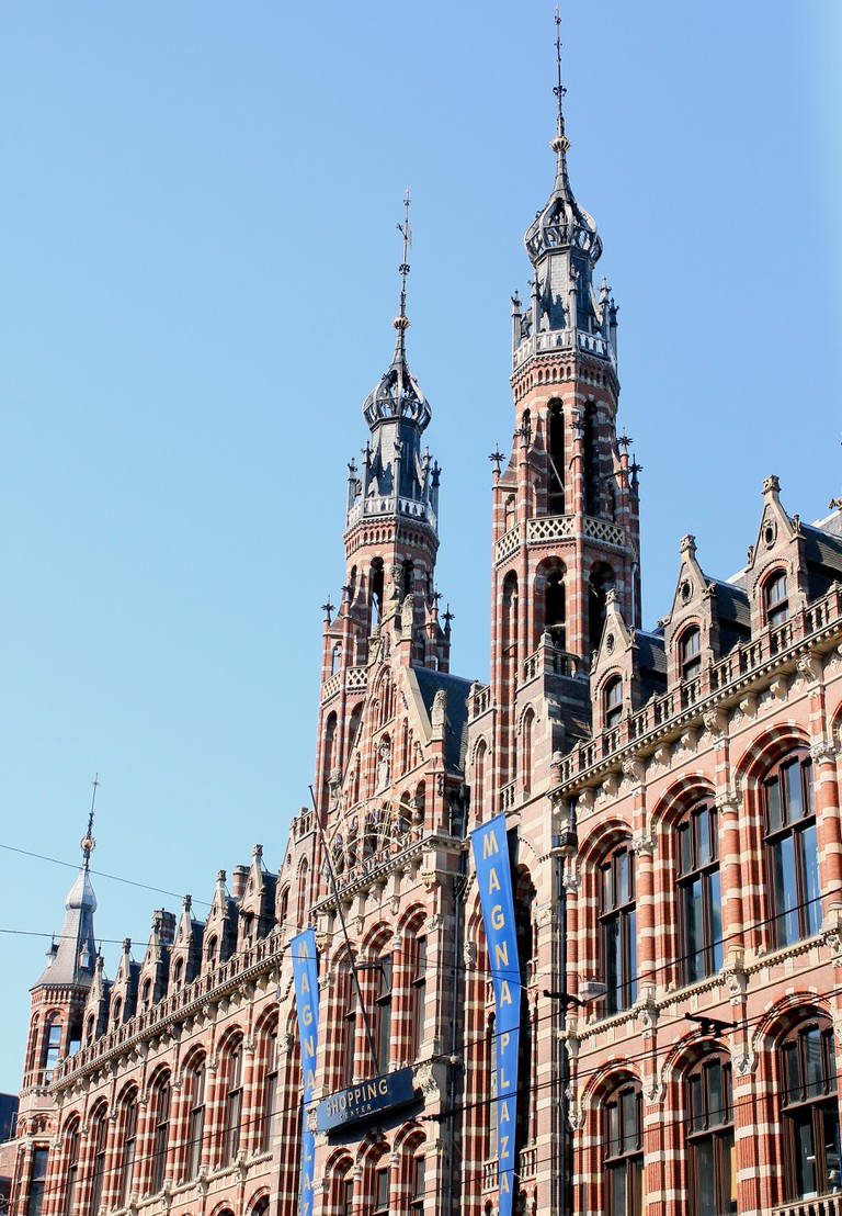 Late 19th century Neo Gothic Magna Plaza shopping mall at Nieuwezijds Voorburgwal, Amsterdam.