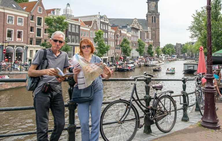 Tourists Reading A Street Map Amsterdam Holland