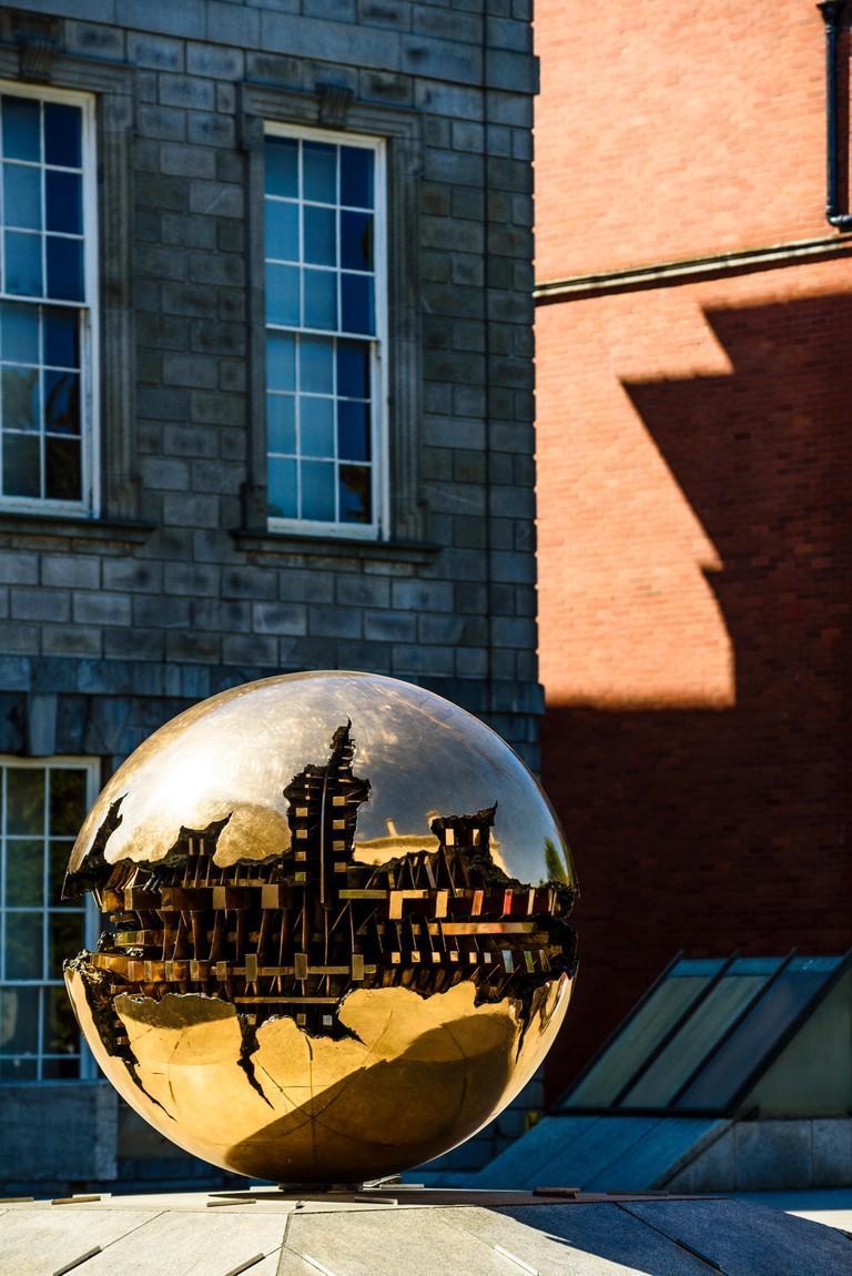 Sphere Within Sphere (Sfera con sfera) sculpture by Arnaldo Pomodoro, Trinity College Dublin, Ireland. Image shot 05/2016. Exact date unknown.