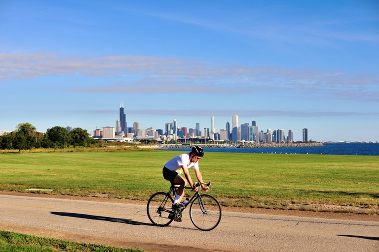 A solitary cyclist pedaling along a path on Chicago's south side.