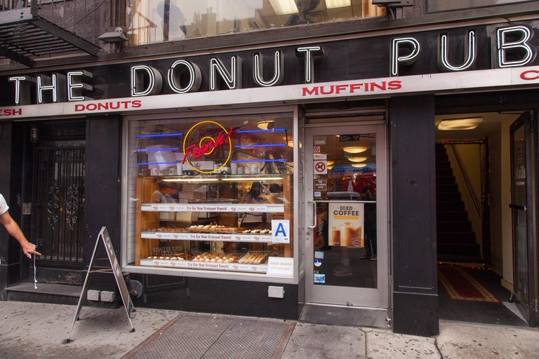 The Donut Pub selling pastries, sandwiches & coffee, W14th Street, Chelsea, New York City, United States of America.