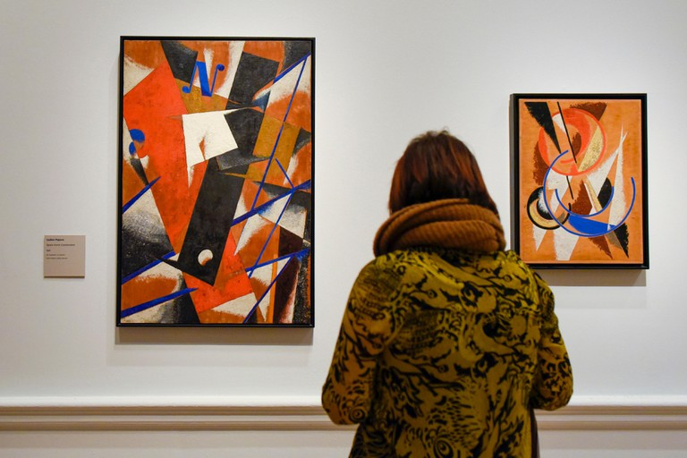 London, UK. 7th Feb, 2017. A visitor views two works, both called Space-Force Construction, by Lyubov Popova at the preview of an exhibition entitled Revolution Russian Art 1917-1932, which marks the centenary of the Russian Revolution. The exhibition run