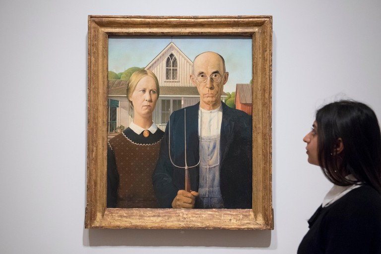 """American Gothic"", 1930 by Grant Wood, at the preview of ""America after the Fall: Painting in the 1930s"", an exhibition of 45 seminal paintings chronicling the impact of the decade following the Wall Street Crash of 1929"