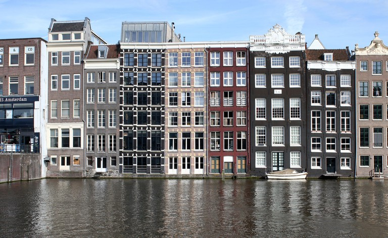 17th century waterfront houses between Warmoesstraat and Damrak canal, central Amsterdam.