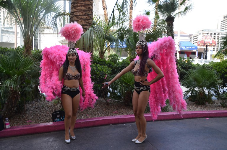 las vegas showgirls in pink feather boas and headresses on the strip nevada usa