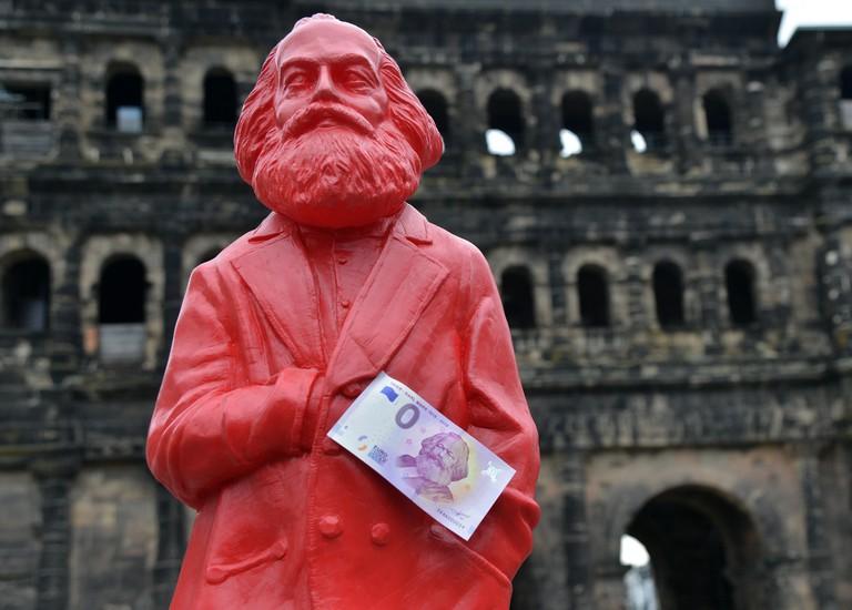 Karl Marx figurine holding a zero-euro bill, Trier, Germany