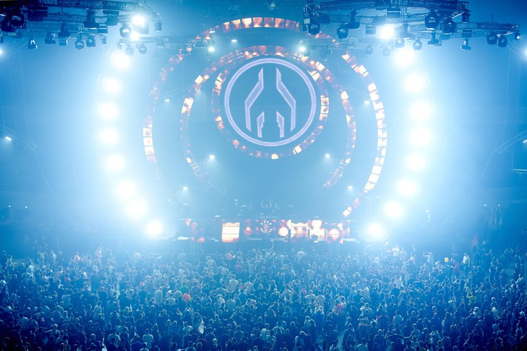 30 April 2018, Germany, Dortmund: techno fans dancing in the Westfalenhalle at the Mayday techno festival. For this year's mother of all raves, which has existed since 1991, organizers are expecting a total of 35 international artists on three stages. Pho