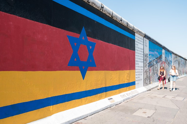 The Berlin Wall / East Side Gallery with painting combining the german and israeli flag (Vaterland by Gunther Schafer)